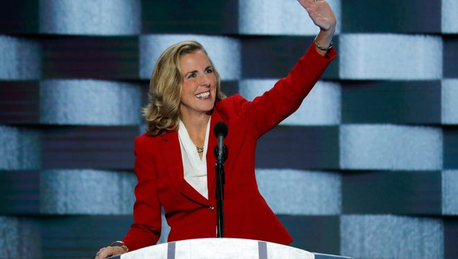 Senate candidate Katie McGinty, D-Pa., waves to delegates before speaking during the final day of the Democratic National Convention in Philadelphia.