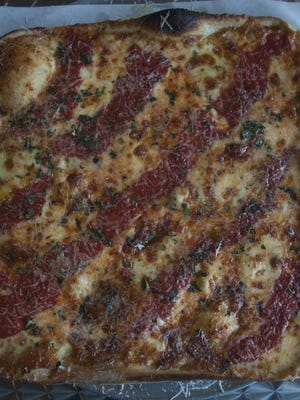 Grandma Pie thin crust pan pizza is a big hit at Angelo's Pizza in Haddonfield.