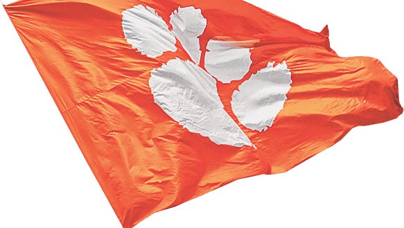 3:25 p.m. -- A Clemson flag is waved after a Tiger TD on Aug. 15, 2007. The Greenville News swarmed the Clemson area from 7 a.m. to 10 p.m. for its special Day in the Life section.