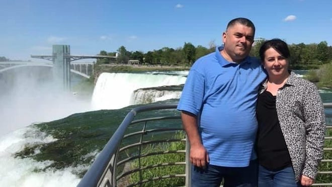 Oksana Zakharchyshyn (pictured with her husband, Ihor) was struck and killed by a motorist June 20 in Webster. A Penfield man now has been charged in connection with the hit-and-run.