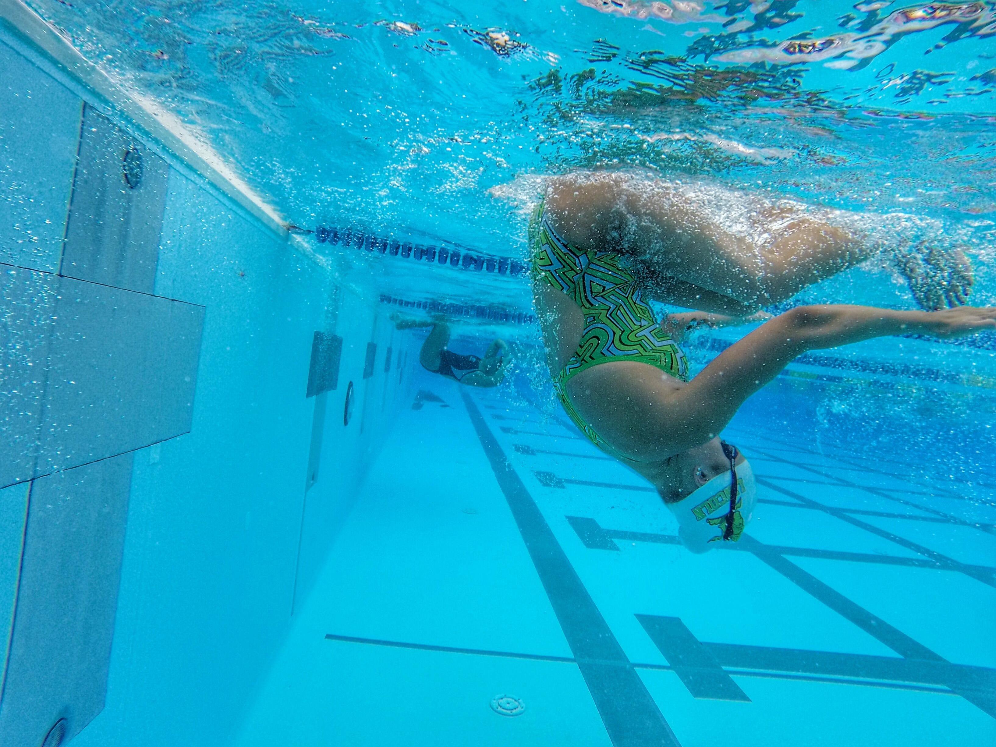 Lincoln junior Sara-Kellett Clark makes her flip while swimming practice laps at Trousdell Aquatic Center.