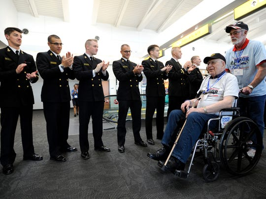 Veterans are greeted by members of the U.S. Naval Academy upon arriving in Washington, D.C., on the Honor Flight. On April 18, a plane filled with 81 veterans from World War II, the Korean War and the Vietnam War took part in the Honor Flight Columbus trip to the nation's capital.