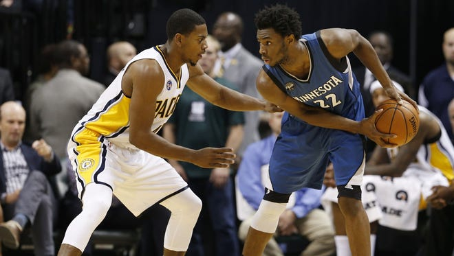 Indiana Pacers forward Glenn Robinson III (40) guards Minnesota Timberwolves forward Andrew Wiggins (22) at Bankers Life Fieldhouse. Indiana defeats Minnesota 107-103.