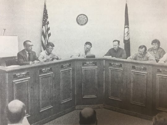 County officials received a new desk and tried it out during a Union County Fiscal Court session in February 1986. The new desk allowed magistrates to directly face visitors.