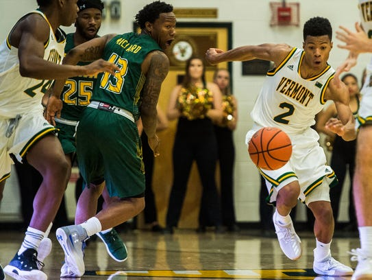 Trae Bell-Haynes gets past Siena's Khailil Richard, bouncing the ball between his legs during their men's basketball game on Dec. 11.