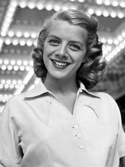 Rosemary Clooney poses under the lights of the Russell