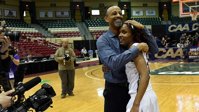 James Madison head coach Kenny Brooks hugs Robert E. Lee grad Angela Mickens after the Dukes defeated Drexel in the championship game of the Colonial Athletic Association tournament March 12 in Upper Marlboro, Md. Brooks stepped down Monday as JMU's coach to take the same position at Virginia Tech.