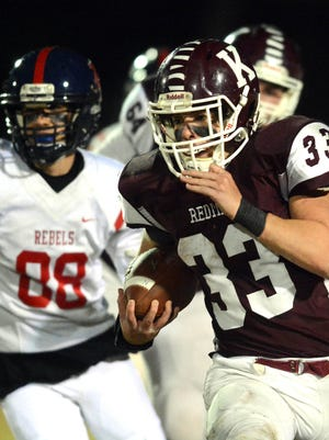 Killingly's Jack Sharpe gets by New Fairfield's Luke Giaquinto for a gain during Killingly's 28-0 CIAC Class M quarterfinal win last December in Killingly.
