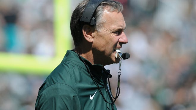 Head coach Mark Dantonio watches during the Green and White Spring Game on Saturday, April 23, 2016 at Spartan Stadium.