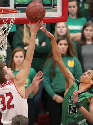 Kimberly High School's #32 Levi Nienhaus-Borchert against Oshkosh North High School's #14 Tyrese Haliburton during their Fox Valley Association boys basketball game on Friday, December 22, 2017, in Kimberly, Wis. 