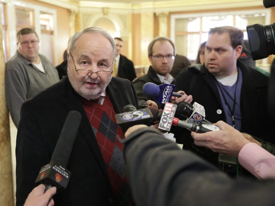 Green Bay Alderman Guy Zima talks to reporters in 2016