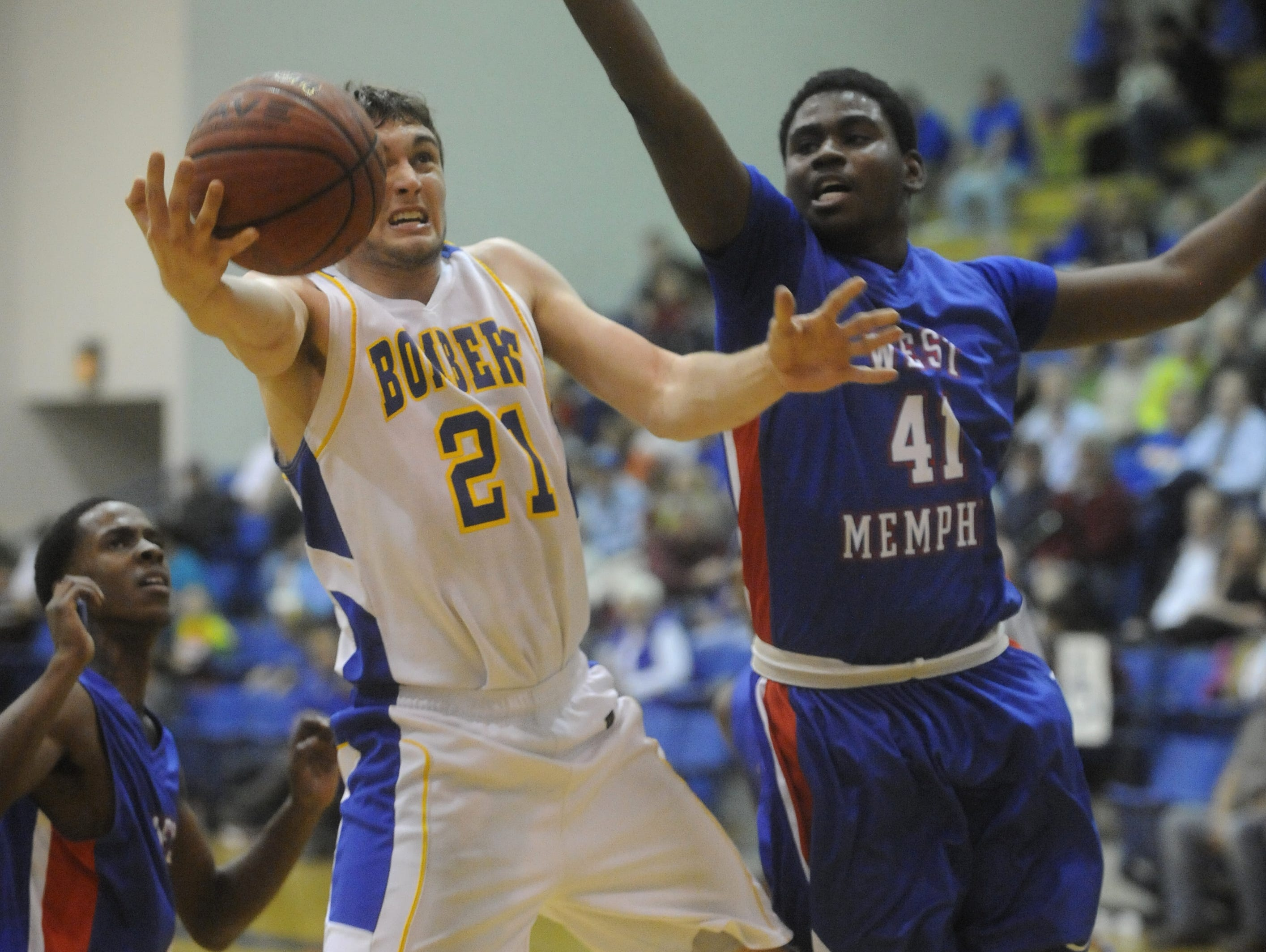 Mountain Home's Howie Wehmeyer (21) goes up for a layup during a game last season against West Memphis.