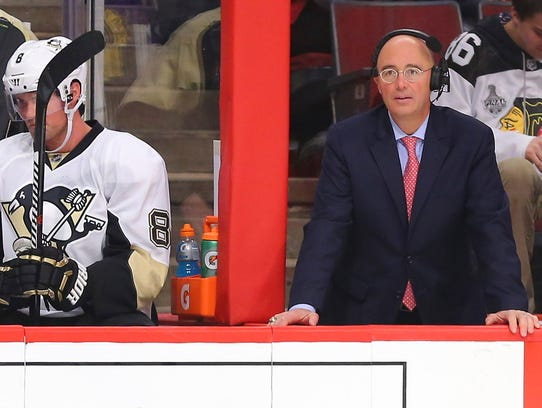 Pierre McGuire looks on during the second period of