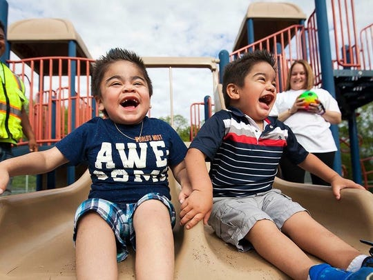 Brothers Aiden and A.J. Sanchez at a playground in