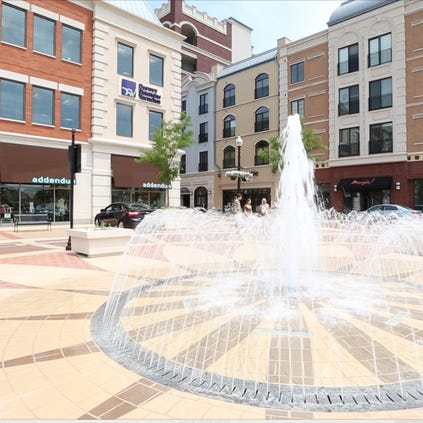 A fountain, shown on June 17, 2014, adds to the ambience of Carmel City Center. Carmel was ranked No. 12 on a list of America's best cities to live by the 24/7 Wall St. special report, featured in USA Today.