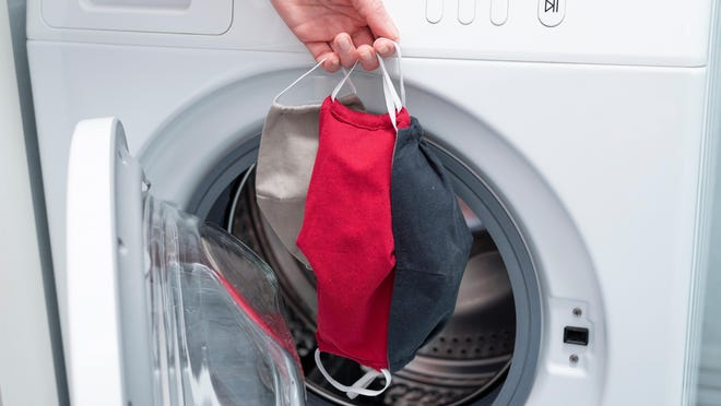 Cloth face masks should be washed after each use.