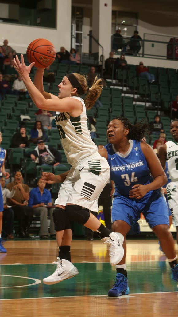 Binghamton University guard Kim Albrecht shoots against the University at Buffalo during the 2013-14 season opener in the Events Center.   Jonathan Cohen / Special to the Press & Sun Bulletin Binghamton University's Kim Albrecht shoots against the University at Buffalo during the Bearcats' opener Nov. 8 at the Events Center. Jonathan Cohen / Special to the Press & Sun Bulletin