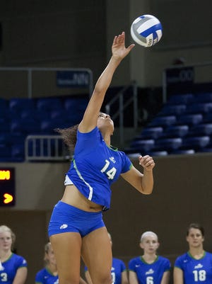 FGCU?s Amanda Carroll serves against Fordham during the  Hilton Garden Inn and Homewood Suites Classic at Alico Arena. FGCU beat Fordham 3-0 on Saturday, Aug. 29, 2015.