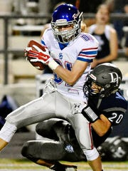 Spring Grove's Brady Stein, left,  gets pulled down