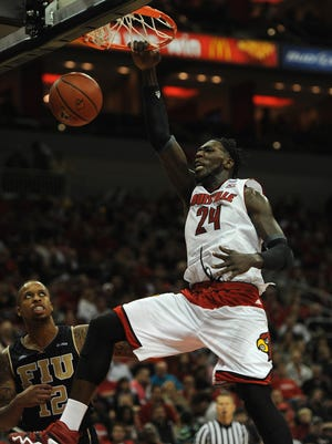 Louisville's Montrezl Harrell (24) dunks against FIU's Dominique Williams (12) on Friday at the KFC Yum! Center. UofL won 82-57. (By David Lee Hartlage, Special to the C-J) Dec. 5, 2014.