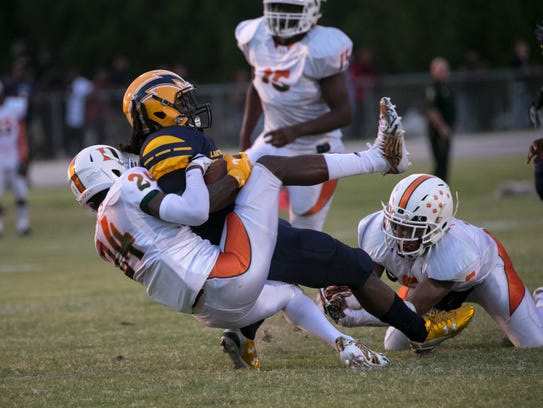 Lehigh's Chris Curry is tackled by Dunbar's Albert