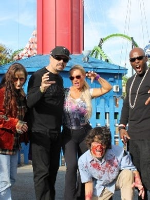 2013: Rapper and actor Ice-T appears with actress wife CoCo and Treach from Naughty by Nature at Six Flags Great Adventure in Jackson. Ghouls from the park's Fright Fest pose with them.