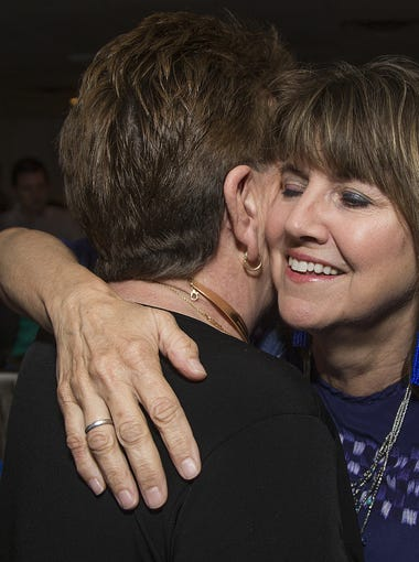 BJ Briggle, Ahwatukee, left, hugs Tempe City Council candidate Lauren Kuby during the Election Day party in Tempe, March 13, 2018.