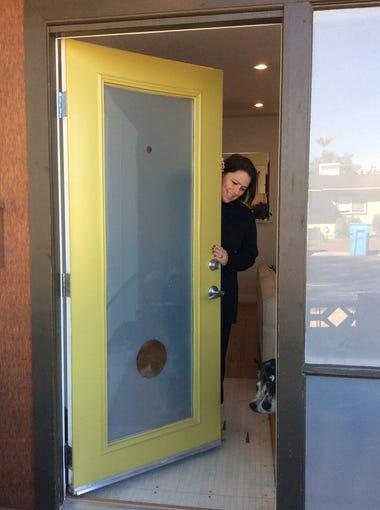 A custom front door greets visitors.
