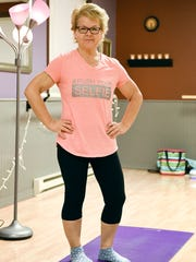 Tammy Habiger's drastic weight loss changed her life. She is shown Wednesday, Jan. 25, before a yoga class at Primal Body Massage & Movement in Waite Park.