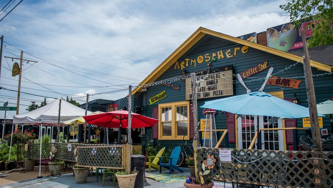 The new main entrance, flanked by outdoor seating, is pictured at Artmosphere Bistro in Lafayette, LA, Wednesday, April 22,2015.