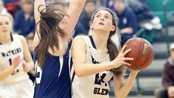 Taylor Kelly of Watkins Glen looks for room to shoot as Bainbridge-Guilford's Megan Palmatier defends Saturday during the Senecas' 37-35 win in the Section 4 Class C championship game at Tompkins Cortland Community College.