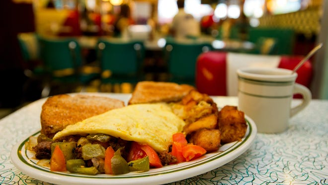The cheeseburger omelette at Hub City Diner is pictured in this Advertiser file photo. Hub City Diner is just one of several local restaurants that will donate 10 percent of the day's sales Thursday to St. Joseph Diner.