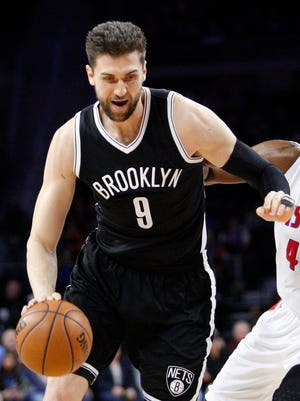 Andrea Bargnani dribbles the ball as Detroit Pistons forward Anthony Tolliver defends during the second quarter at The Palace of Auburn Hills.