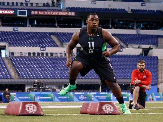 UCLA defensive lineman Kenny Clark participates in workout drills during the 2016 NFL Scouting Combine at Lucas Oil Stadium.