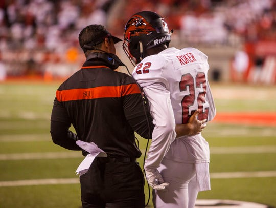Southern Utah head coach Demario Warren talks to cornerback