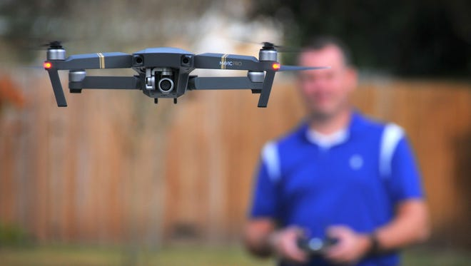 Chris Charron of Titusville was waiting to see if  his wife was  buying  him a drone for Christmas. When she didn't, he bought himself a DJI Mavic Pro that he flies from an app on his phone. Charron has tried to help others locate their missing drones.
