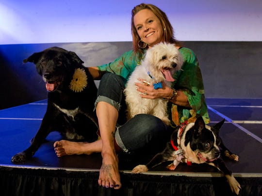 Natalie Moore, owner of Natalie's Second Chance, sits with Greta, from left, Cecil and Charlie in preparation for Woofstock at the Lafayette Theater, in Lafayette, on Aug. 14, 2013.