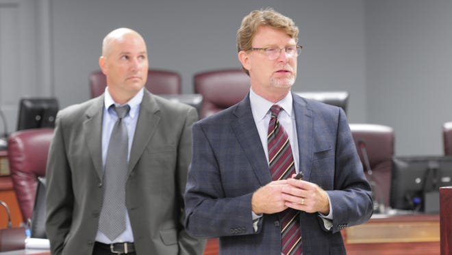 """Doug Tennant, right, vice president for AECOM's Carolinas and Tennessee chapter, and Matt Meservy, senior transportation planner with AECOM, discuss plans for a countywide """"comprehensive traffic strategy"""" study in August 2016 at the county's Administrative Complex in Franklin. The study is expected to be complete in early 2017."""
