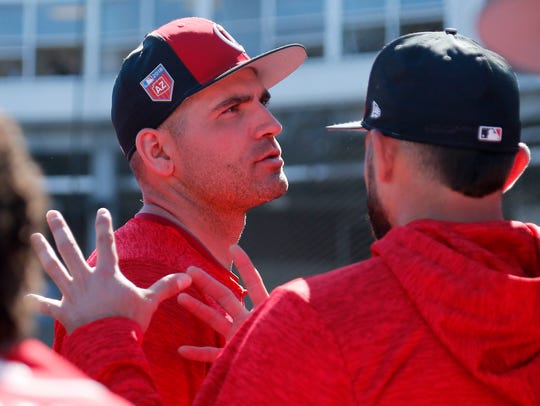 Cincinnati Reds first baseman Joey Votto (19) talks
