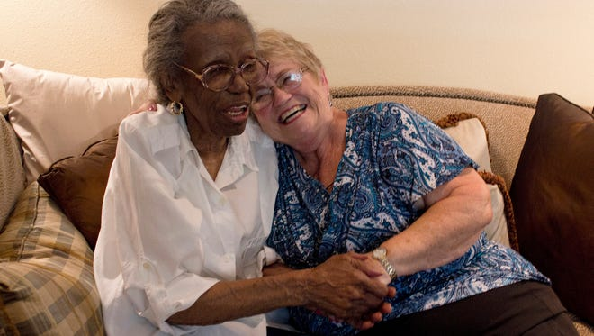 Cleven Cotton (Left) shares story of growing up in Mississippi to Lynda Gustafson (Right).