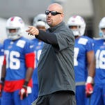 Jul 28, 2013; Pittsford, NY, USA; Buffalo Bills defensive coordinator Mike Pettine points as he talks to the Bills defense during training camp at St. John Fisher College. Mandatory Credit: Kevin Hoffman-USA TODAY Sports