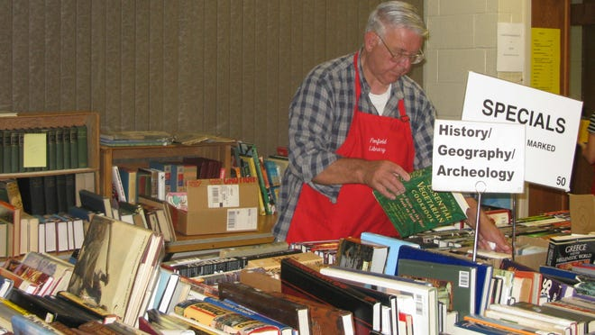 Co-chairs Janet Flanagan and Gary Richardson (that's Gary in the picture) have been managing the Book Sale for many years.