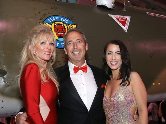 Event co-chair Marguerita Maassen-Gilbertson with husband Dan Gilbertson, chairman of the Board of the Palm Springs Air Museum, with daughter Gabrielle.