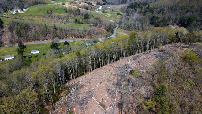 In this Thursday, May 3, 2018 photo, a section of downed trees sits atop a ridge near homes along the route of the proposed Mountain Valley Pipeline in Lindside, W.Va.