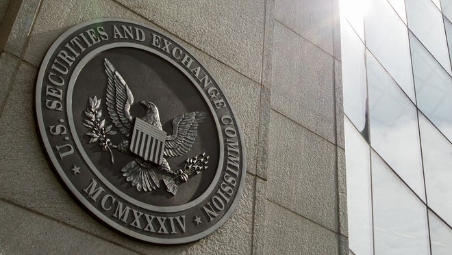 File photo taken in 2015 shows the seal of the U.S. Securities and Exchange Commission outside the regulator's headquarters in Washington, D.C.
