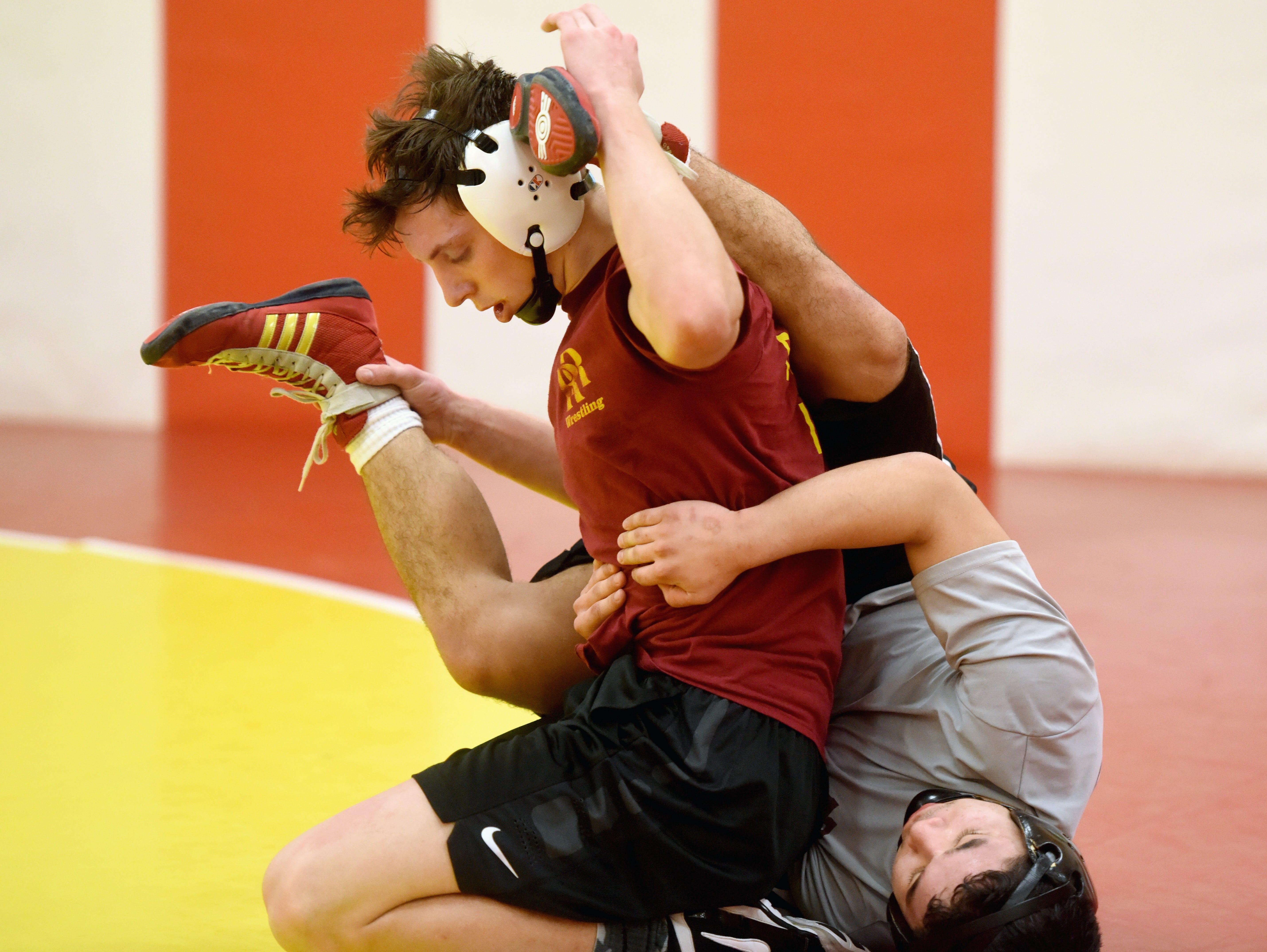 RooseveltÕs Carter Lohr wrestles teammate Josh Cid during practice on Wednesday.