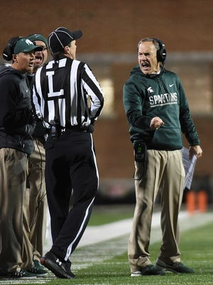 Michigan State coach Mark Dantonio, right, reacts to a penalty in the first half Saturday in College Park, Md.