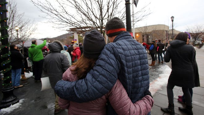 A couple embraces at the #ResistHate rally, organized by Rockland United, at Veterans Park Gazebo in Nyack, Dec. 18, 2016. After a year of divisive politics and growing tensions, we hope for better community understanding in 2017.