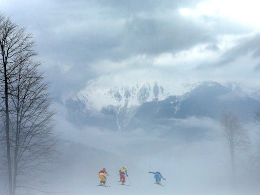 (L-R) Anna Holmlund of Sweden, Stephanie Joffroy of Chile and Katrin Ofner of Austria compete in heavy fog in the Freestyle Skiing Womens' Ski Cross Quarter Finals on day 14 of the 2014 Winter Olympics at Rosa Khutor Extreme Park on February 21, 2014 in Sochi, Russia. Photo by Cameron Spencer/Getty Images