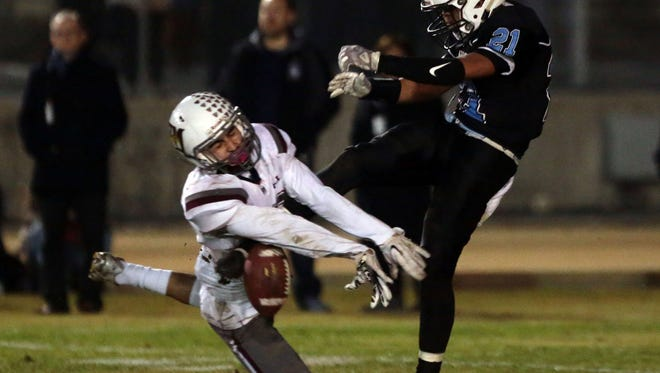 Rancho Mirage Joshua Ramirez knocks loose Arroyo's Cesario Carrillo's punt knick to allow teammate Mason Ferrer to score in the 3rd during the CIF Division 12 finals on Saturday, December 3, 2016 in El Monte.